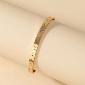 Roman numeral engraved cuff bangle bracelet